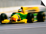 Yellow Race Car in Motion