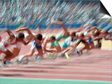 Blured Action at the Start of a Mens 100 Meter Track and Field Race