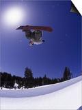 Airborne Snowboarder in Half Pipe Position