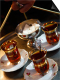 Hand Holding a Tray with Turkish Tea  Istanbul  Turkey  Europe