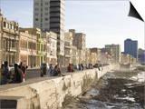 View Along the Malecon  People Sitting on the Seawall Enjoying the Evening Sunshine  Havana  Cuba