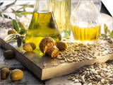 Various Oils in Carafes  Olives  Sunflower Seeds