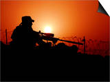 A US Special Forces Soldier Armed with a Mk-12 Sniper Rifle at Sunset