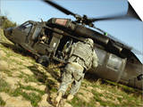 US Army Soldiers Board a UH-60 Black Hawk Helicopter