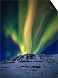 Aurora Borealis over Toviktinden Mountain in Troms County  Norway