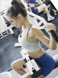 Young Woman Exercising in a Health Club