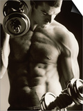 Close-up of a Young Man Working Out with Dumbbells