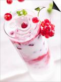 Redcurrants Falling into a Layered Yogurt Dessert