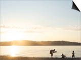 Silhouette of Mother Taking Pictures of Children at Sunset  Vashon Island  Washington State  USA