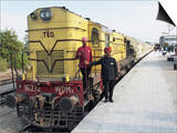 Staff Members for the Palace on Wheels Train Posing with the Train  Udaipur  India