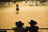 Silhouette of Cowboys at Indoor Rodeo