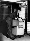 Man Throwing Away Newspaper