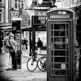 Loving Couple Kissing and Red Telephone Booth - London - UK - England - United Kingdom - Europe