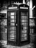 Old Black Telephone Booth on a Street in London - City of London - UK - England - United Kingdom