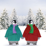 Penguins in Duffle Coats and Scarves Holding