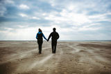 A Couple Together on a Winters Day on a Beach