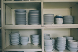 A Cupboard Full of Cups and Saucers