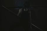 Young Man Posing in Dark Setting