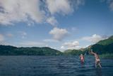 People Bathing in a Lake