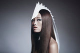 Female Model Wearing White Head Piece