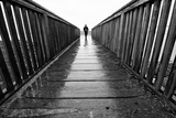 Male Figure Walking on Pier