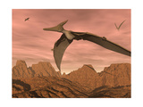 Three Pteranodon Dinosaurs Flying Above Rocky Landscape