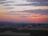 Sun Rising over Rural Landscape