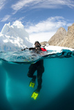Diver in Front of an Iceberg  Astrolabe Island  Antarctic Peninsula  Antarctica