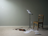 Empty Room with Chair  Violin and Sheet Music on Floor