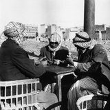 Men Playing Domino at the Table of a Cafe in Baghdad
