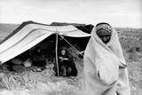 A Bedouin Family Smiling Outside a Tent