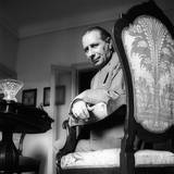 Giuseppe Ravegnani Looks at the Camera  Sitting on His Armchair
