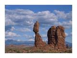 Balanced rock under cloudy skies  Arches National Park  Utah
