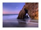 Sea arch and full moon over El Matador State Beach  Malibu  California