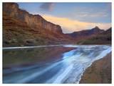 Ice on the Colorado River beneath sandstone cliffs  Cataract Canyon  Utah