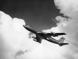 1960S American Airlines A-707 Jet Ascending through Clouds