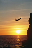 Cliff Diver above Setting Sun