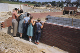 Family Observing a School Construction Site