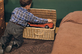 Boy Removing Fire Engine from Toy Chest