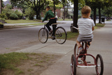 Boys Riding their Bike and Tricycle
