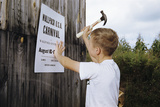 Boy Hammering Fair Sign