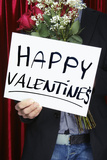 Man Holding Happy Valentine's Sign