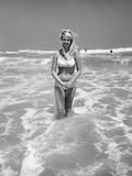 Woman Standing in Ocean Surf