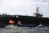 Ship and Boats with Flag Carriers against the Nuclear Vessel