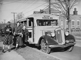 Children Getting off School Bus