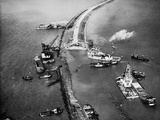 Aerial View of Ships Building a Dyke