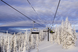 Skiers Ride Chairlift at Whitefish Mountain Resort  Montana  Usa