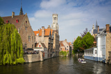 Tourist on Boat Ride Through the Canals of Bruges  Belgium