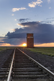Granary and Railroad Track Lead into the Sunset  Collins  Montana  Usa