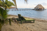 Placencia  Belize Lounge Chairs on Groomed Sandy Beach